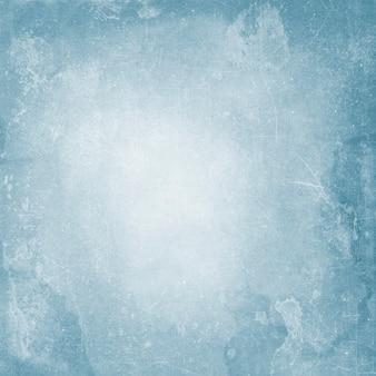 La trama della vecchia carta vintage blu in macchie e graffi per un design con una copia dello spazio