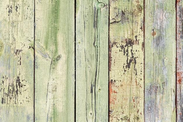 La trama del vecchio recinto di legno blu. spazio per il testo. sfondo.