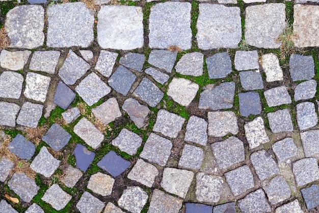 Struttura di vecchio primo piano cobbled pavement. sfondo astratto di pietra.