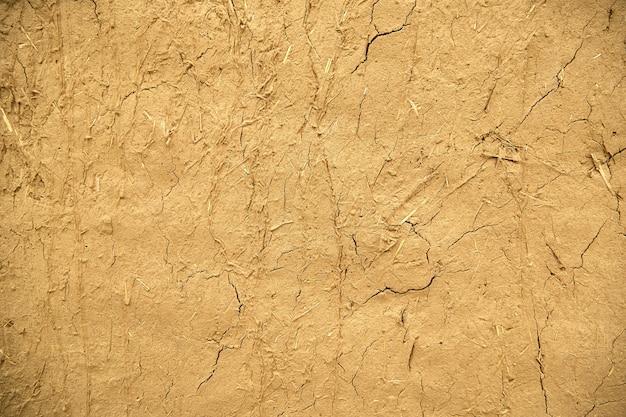 Texture di un vecchio sfondo muro di sabbia incrinata.