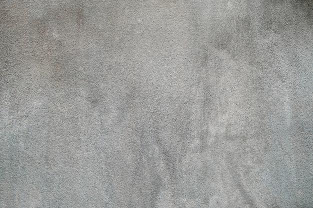 Consistenza del vecchio muro di cemento grigio per lo sfondo.
