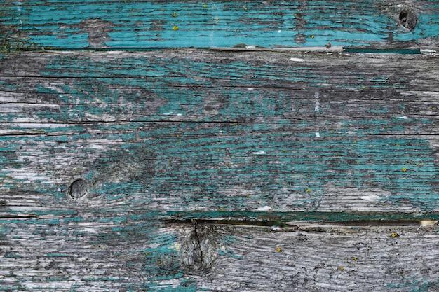 Trama di legno vecchio con peeling vernice blu, struttura in legno blu, vecchia struttura in legno
