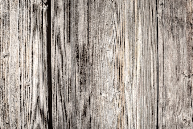 Trama di vecchie tavole di recinzione in legno. sfondo di struttura di legno