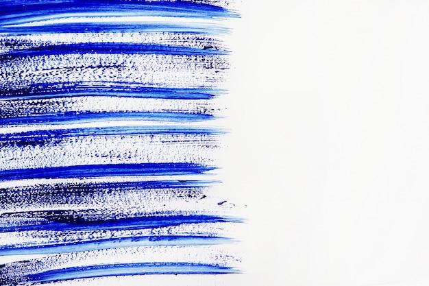 Texture di vernice su sfondo bianco. messa a fuoco selettiva
