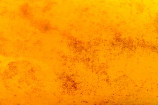 Texture papaya. pelle di frutta. avvicinamento. sfondo