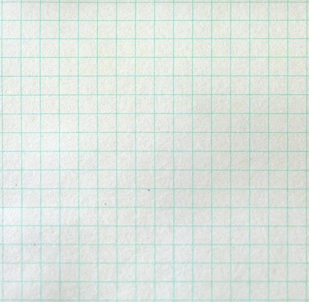 La trama dello sfondo della carta. fogli bianchi di carta quadrata ea righe da un blocco su sfondo grigio