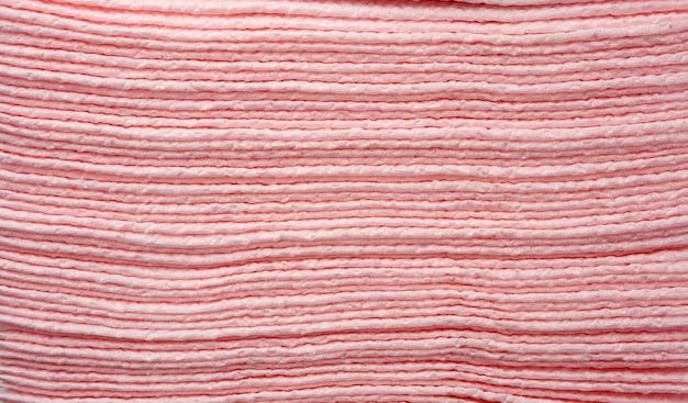 Struttura dei tovaglioli di carta rosa, fine su