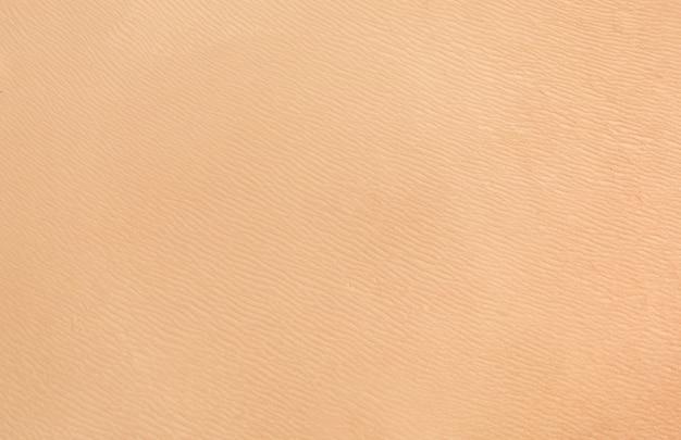 Texture di sabbia su una spiaggia tropicale o nel deserto