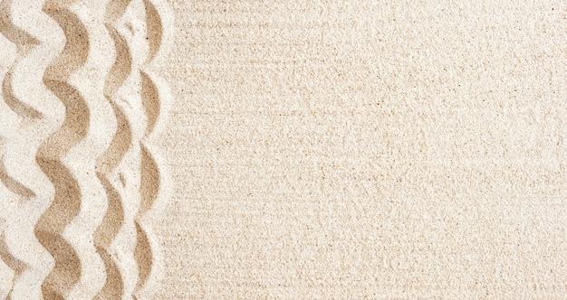 Texture spiaggia sabbiosa per lo sfondo. vista dall'alto, copia spazio, banner