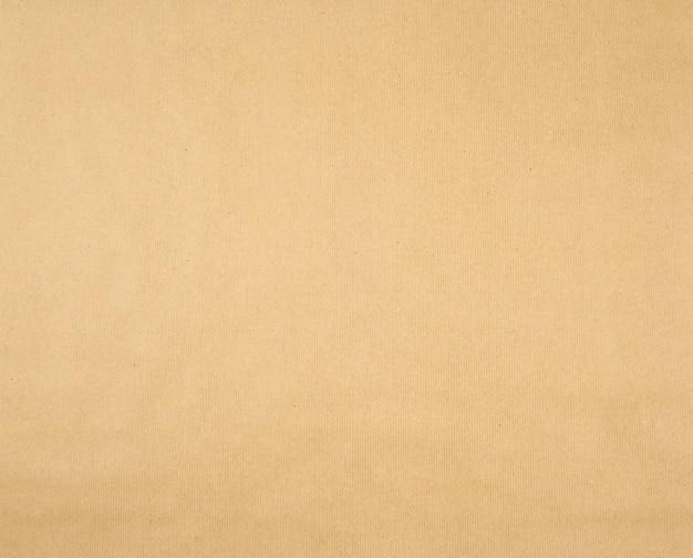 Struttura del fondo marrone liscio della carta da imballaggio di kraft