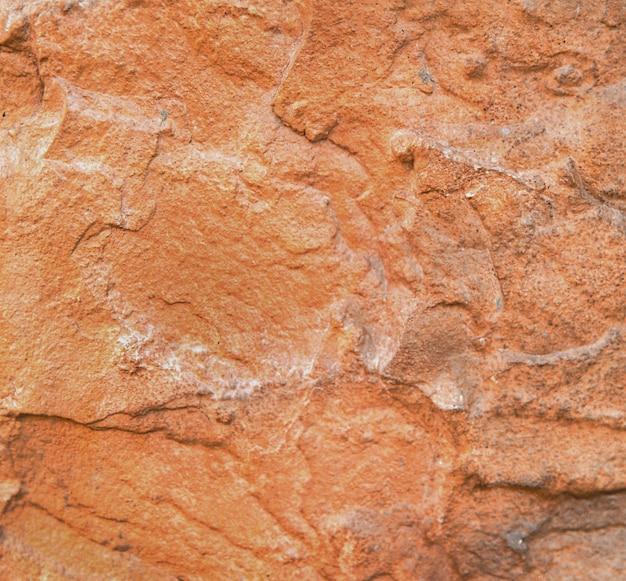 La trama di una solida pietra marrone occupa l'intera cornice, lo sfondo strutturato