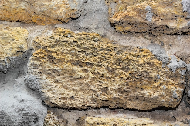 Texture di muro di pietra e sfondo di cemento