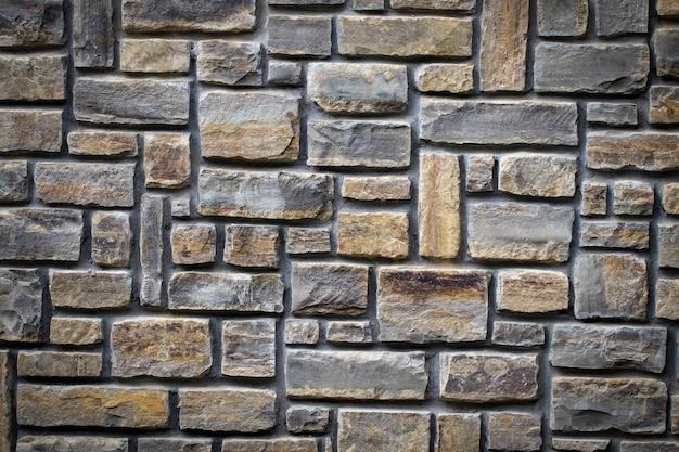 Texture di un muro di pietra. parte di un muro di pietra, per lo sfondo o la trama.