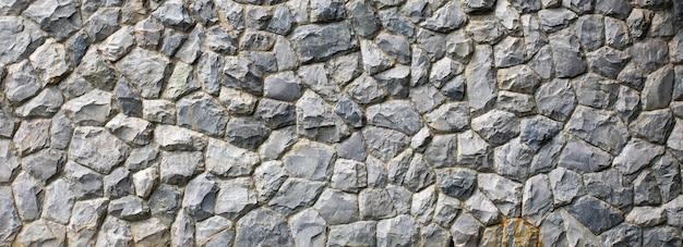 Consistenza del muro di pietra. la struttura senza giunte della parete di roccia