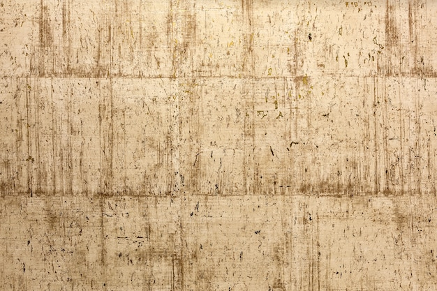 Texture di un muro di pietra con oro lo sfondo astratto di bellezza dalla superficie goffrata testurizzata