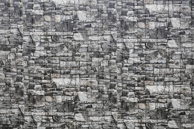 La consistenza delle pietre. piastrella strutturata in pietra. modello di pietra sulla piastrella.