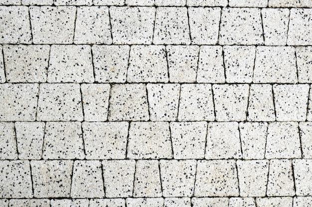 Struttura delle mattonelle del primo piano moderno della pavimentazione. sfondo astratto muro.