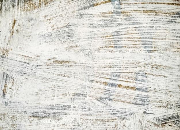 Struttura della parete dipinta in bianco e grigio. sfondo grunge con copia-spazio