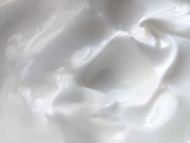 Texture di crema bianca per la cura. sfondo di bellezza.
