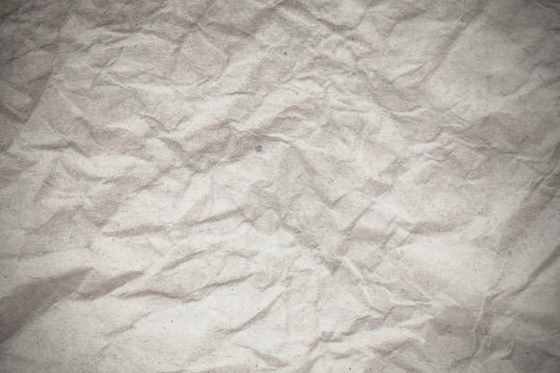Fondo di carta stropicciato bianco di struttura.
