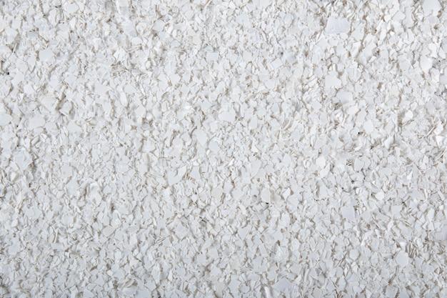 Texture con guscio d'uovo bianco schiacciato fertilizzante naturale.