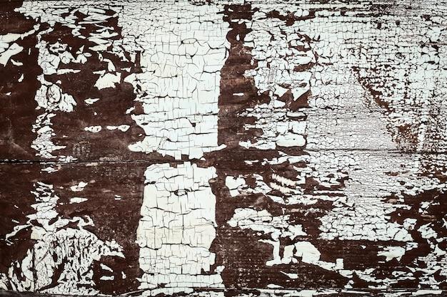 Trama di tavole di legno con vernice scrostata. trama di vecchie tavole di recinzione in legno. sfondo di struttura di legno