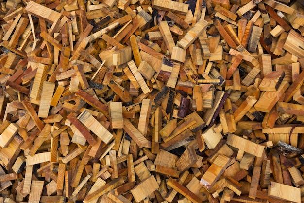 Struttura. scarti di lavorazione del legno. cumuli di trucioli, corteccia, pezzi e segatura. foto di alta qualità