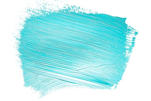 Pennellata di vernice blu con texture su bianco