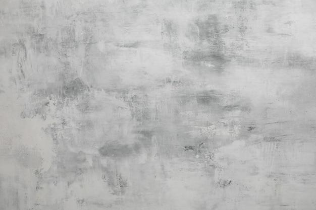 Modello di parete grigio chiaro strutturato con intonaco per il design. sfondo grigio con copyspace.