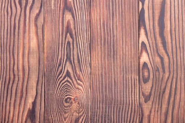 Superficie strutturata del primo piano delle plance del pino marrone