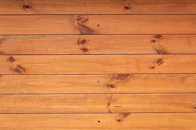 Priorità bassa di legno strutturata, assi di legno di colore marrone-rosso, sfondo per il cibo, in primo piano