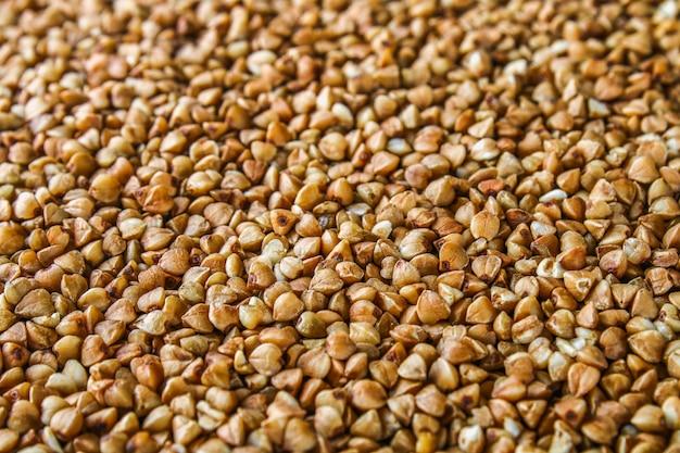 Textures da chicchi di grano saraceno grezzo. cibo salutare. vista dall'alto