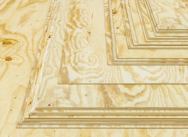 Pannelli sottili di compensato di pino impilati. industria di costruzioni. rendering 3d.