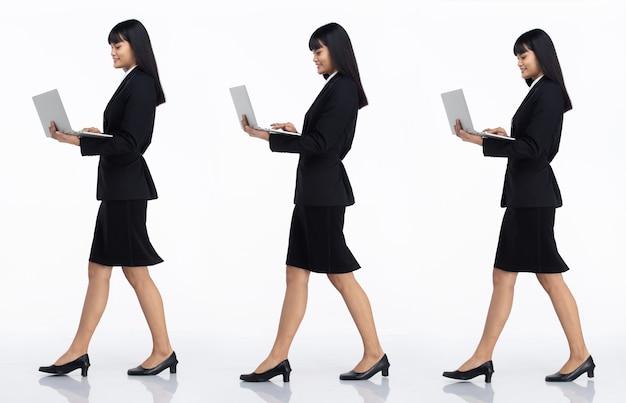 Tre collage tutta la lunghezza degli anni '20 affari asiatici in ufficio donna nera capelli corti indossare gonna abito scuro e scarpe. la femmina porta il laptop per lavorare e camminare vista laterale su sfondo bianco isolato