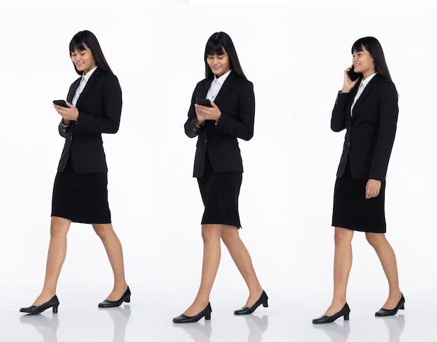 Tre collage tutta la lunghezza degli anni '20 affari asiatici in ufficio donna nera capelli corti indossare gonna abito scuro e scarpe. femmina tenere smart phone per parlare e camminare vista laterale su sfondo bianco isolato