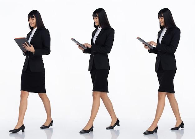 Tre collage tutta la lunghezza degli anni '20 affari asiatici in ufficio donna nera capelli corti indossare gonna abito scuro e scarpe. tablet tenere femmina per lavorare e camminare vista laterale su sfondo bianco isolato