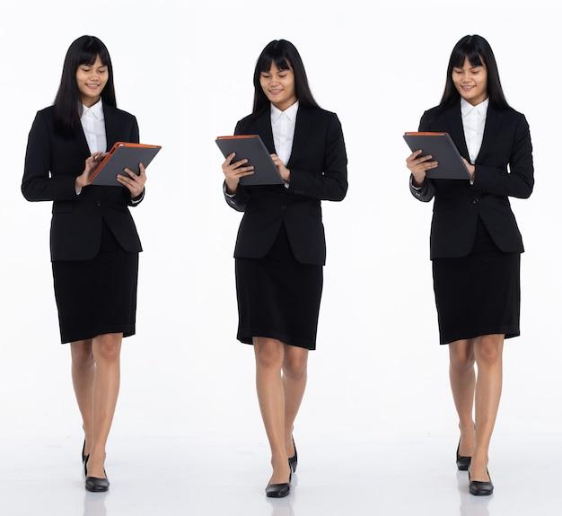 Tre collage tutta la lunghezza degli anni '20 affari asiatici in ufficio donna nera capelli corti indossare gonna abito scuro e scarpe. tablet tenere femmina per lavorare e camminare verso su sfondo bianco isolato