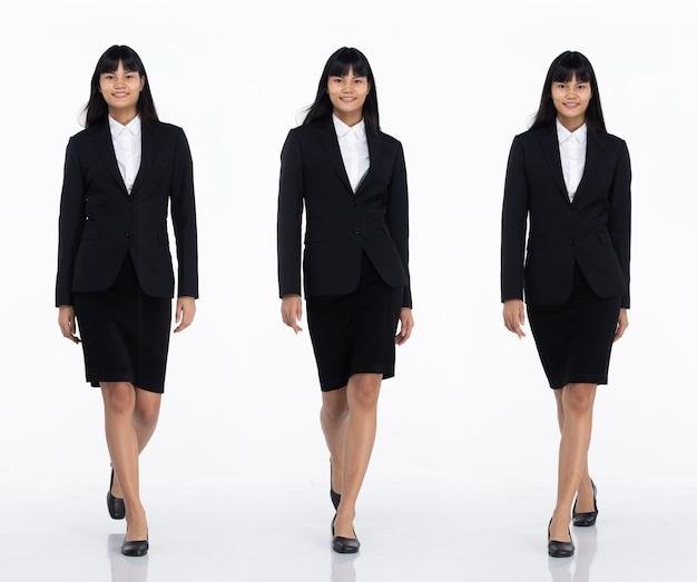 Tre collage tutta la lunghezza degli anni '20 affari asiatici in ufficio donna nera capelli corti indossare gonna abito scuro e scarpe. camminata femminile verso la telecamera su sfondo bianco isolato