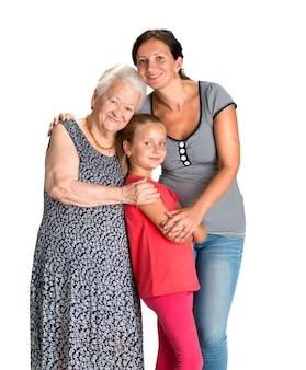Tre generazioni di donne isolate su bianco Foto Premium