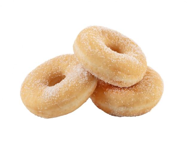 Tre semplici ciambelle di zucchero su uno sfondo bianco