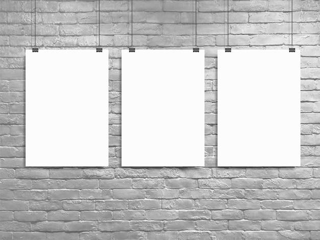 Tre poster mock up muro di mattoni bianchi