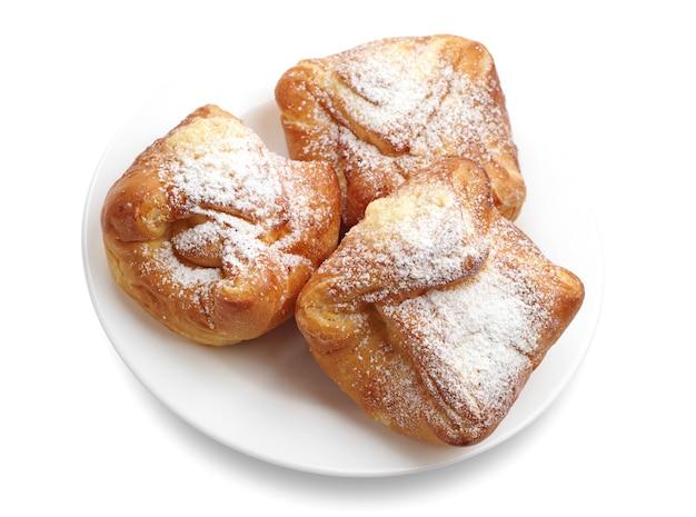 Tre panini dolci su sfondo bianco