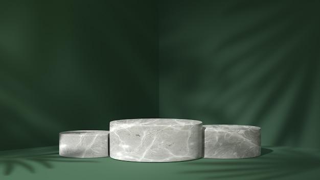Podio di tre cilindri in marmo bianco per l'inserimento di prodotti sullo sfondo di foglie d'ombra