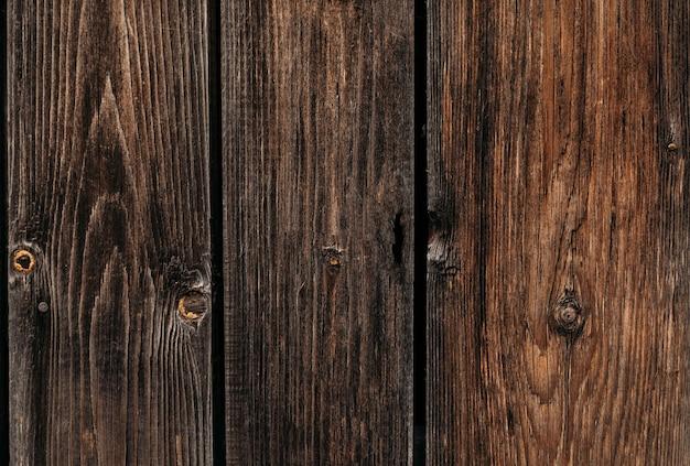 Tre larghe assi di legno con texture di sfondo marrone scuro macro foto di alta qualità