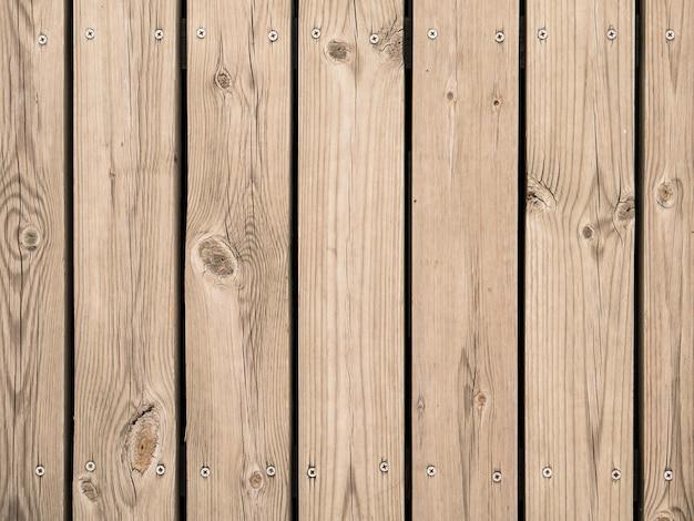 Fondo della parete in legno con viti
