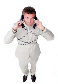 Imprenditore stanco groviglio nei fili del telefono