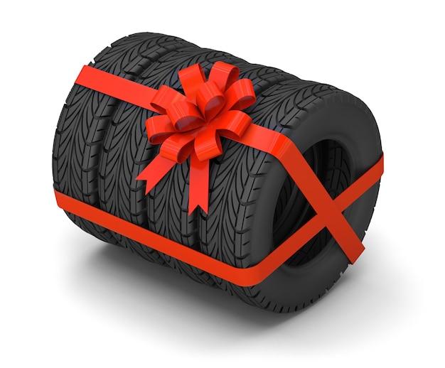 Pneumatici in regalo. un set di quattro pneumatici con un nastro regalo rosso con un fiocco. isolato su sfondo bianco. rendering 3d.