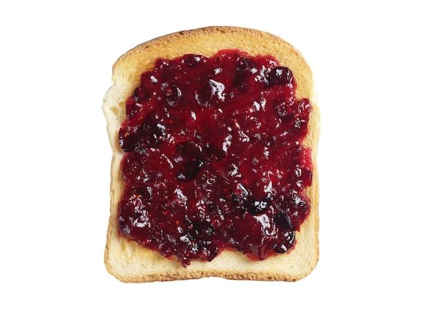 Pane tostato con marmellata di mirtilli rossi da frutti di bosco isolati