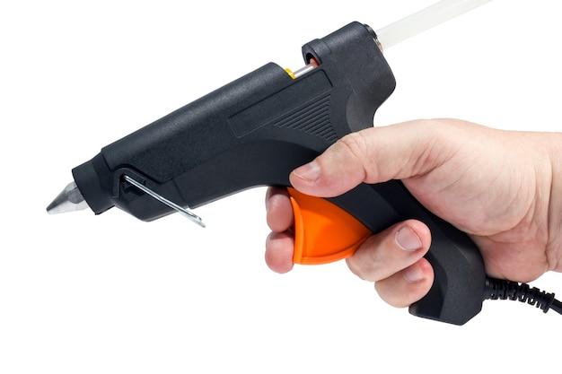 Collezione di strumenti - pistola elettrica per colla a caldo isolata su uno sfondo bianco.