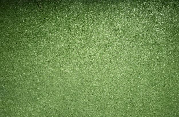 Vista dall'alto della trama di erba verde artificiale per il calcio